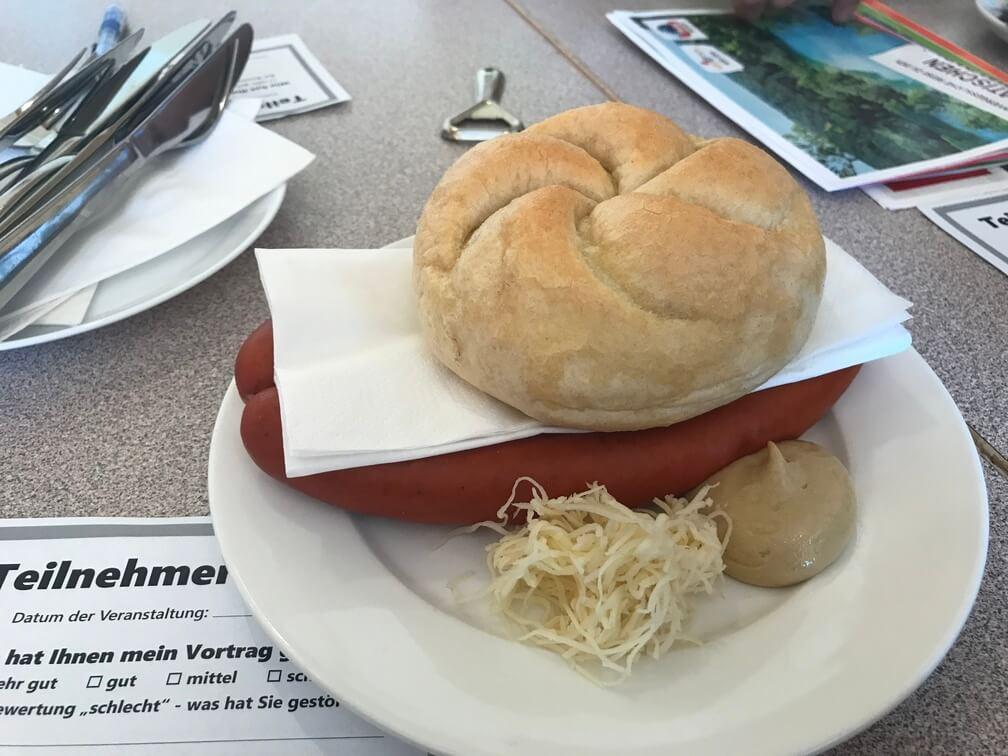 Debreziner mit Semmel in Gmunden, Austria - Archievald Travel and Food