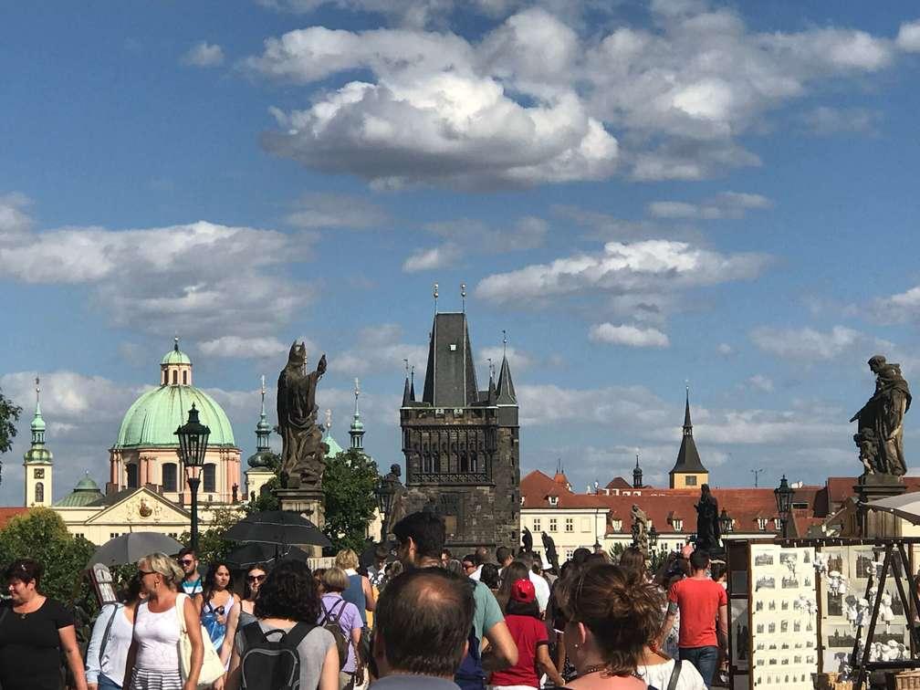 Walking in Charles Bridge in Prague, Czech Republic - Archievald Travel